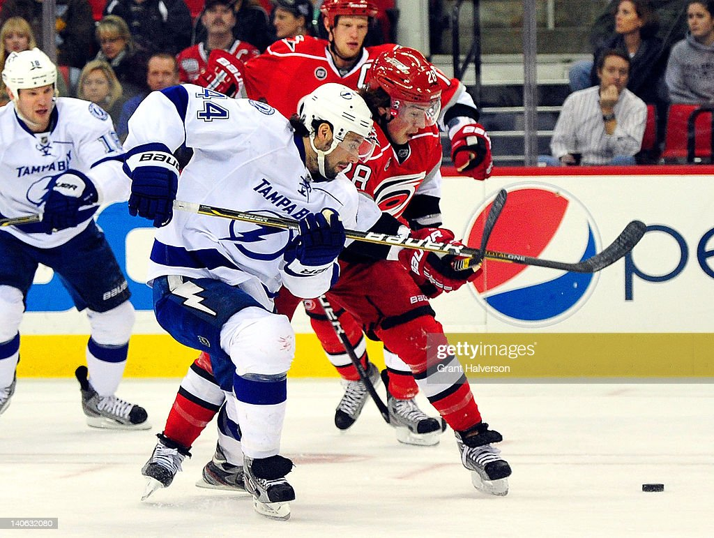Nate Thompson #44 of the Tampa Bay Lightning vies for the puck with Justin Faulk #28 of the Carolina Hurricanes during play at the RBC Center on March 3, 2012 in Raleigh, North Carolina.