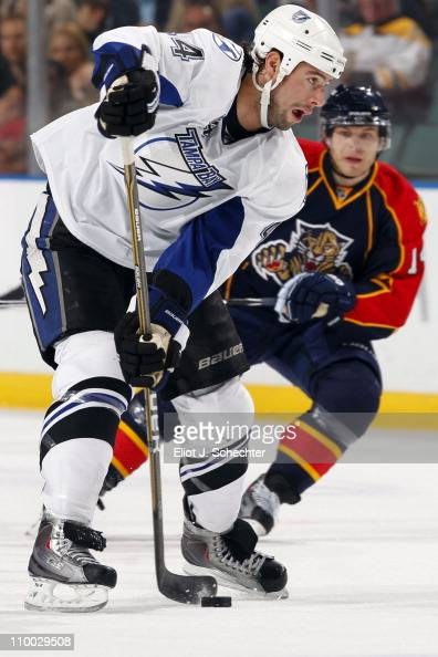 Nate Thompson skates with the puck against Sergei Samsonov of the Florida Panthers at the BankAtlantic Center on March 12 2011 in Sunrise Florida