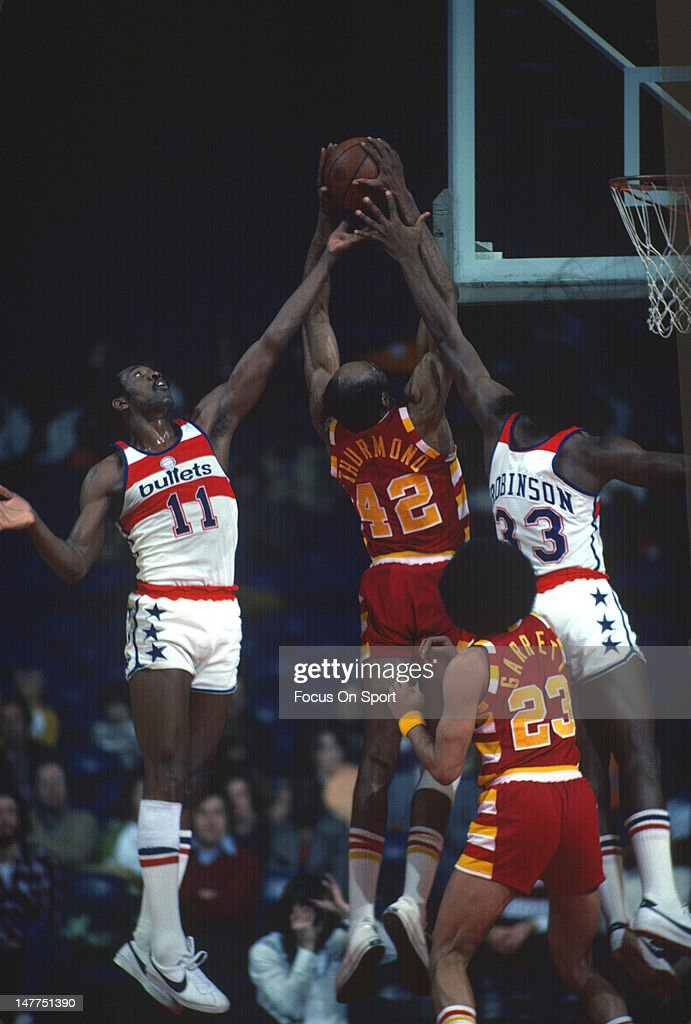 Nate Thurmond $42 of the Cleveland Cavaliers battle for a rebound with Elvin Hayes and Truck Robinson of the Washington Bullets during an NBA...