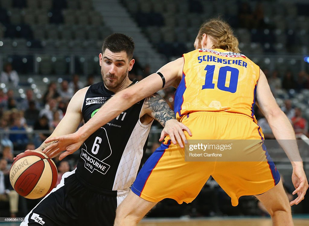 Nate Tomlinson of Melbourne United is challenged by Luke Schenscher of the Adelaide 36ers during the round eight NBL match between Melbourne United...