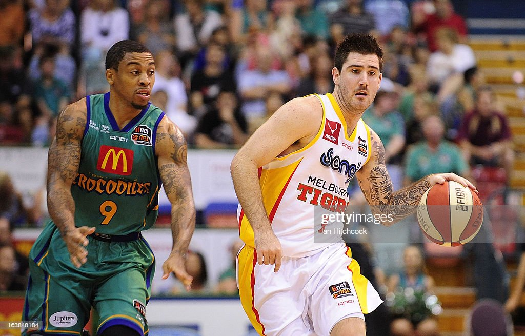 Nate Tomlinson of the Tigers looks to get past Gary Ervin of the Crocodiles during the round 23 NBL match between the Townsville Crocodiles and the Melbourne Tigers at Townsville Entertainment Centre on March 17, 2013 in Townsville, Australia.