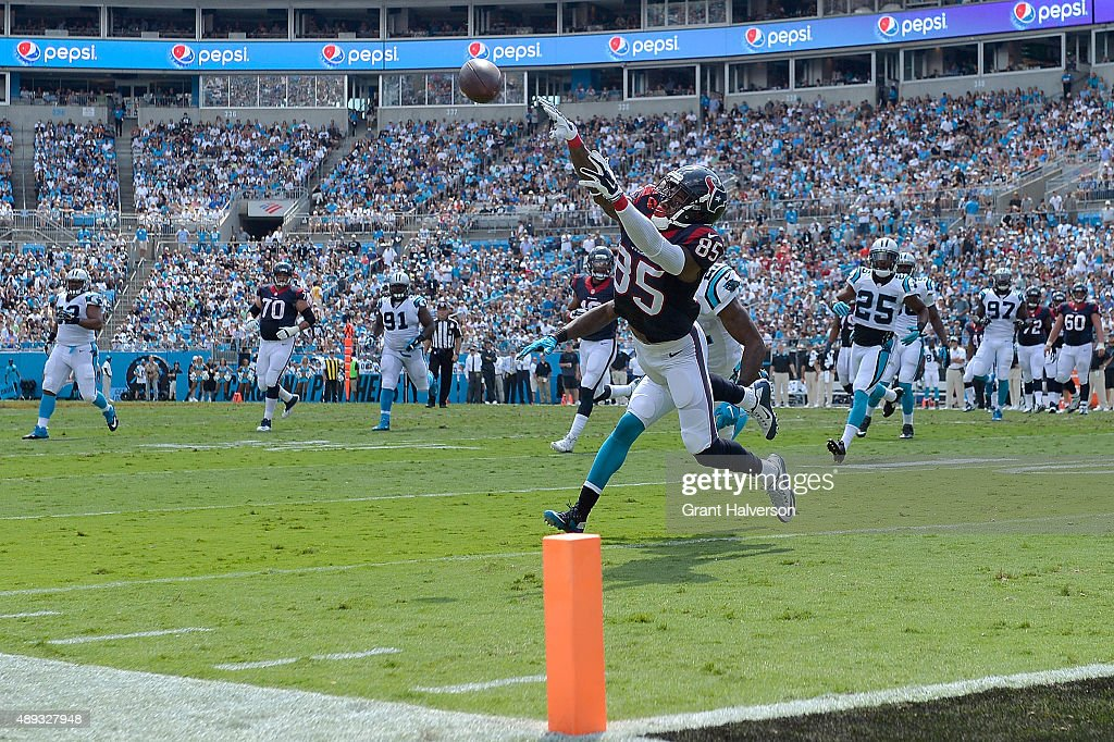 <a gi-track='captionPersonalityLinkClicked' href=/galleries/search?phrase=Nate+Washington&family=editorial&specificpeople=748657 ng-click='$event.stopPropagation()'>Nate Washington</a> #85 of the Houston Texans makes a diving attempt to catch an overthrown ball against the Carolina Panthers during their game at Bank of America Stadium on September 20, 2015 in Charlotte, North Carolina.