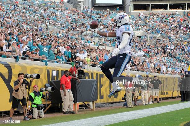 Nate Washington of the Tennessee Titans celebrates a touchdown against the Jacksonville Jaguars during a game at EverBank Field on December 22 2013...