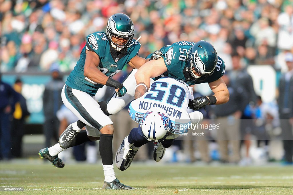 <a gi-track='captionPersonalityLinkClicked' href=/galleries/search?phrase=Nate+Washington&family=editorial&specificpeople=748657 ng-click='$event.stopPropagation()'>Nate Washington</a> #85 of the Tennessee Titans is tackled by <a gi-track='captionPersonalityLinkClicked' href=/galleries/search?phrase=Casey+Matthews&family=editorial&specificpeople=6164562 ng-click='$event.stopPropagation()'>Casey Matthews</a> #50 and <a gi-track='captionPersonalityLinkClicked' href=/galleries/search?phrase=Bradley+Fletcher&family=editorial&specificpeople=4620736 ng-click='$event.stopPropagation()'>Bradley Fletcher</a> #24 of the Philadelphia Eagles in the second quarter of the game at Lincoln Financial Field on November 23, 2014 in Philadelphia, Pennsylvania.