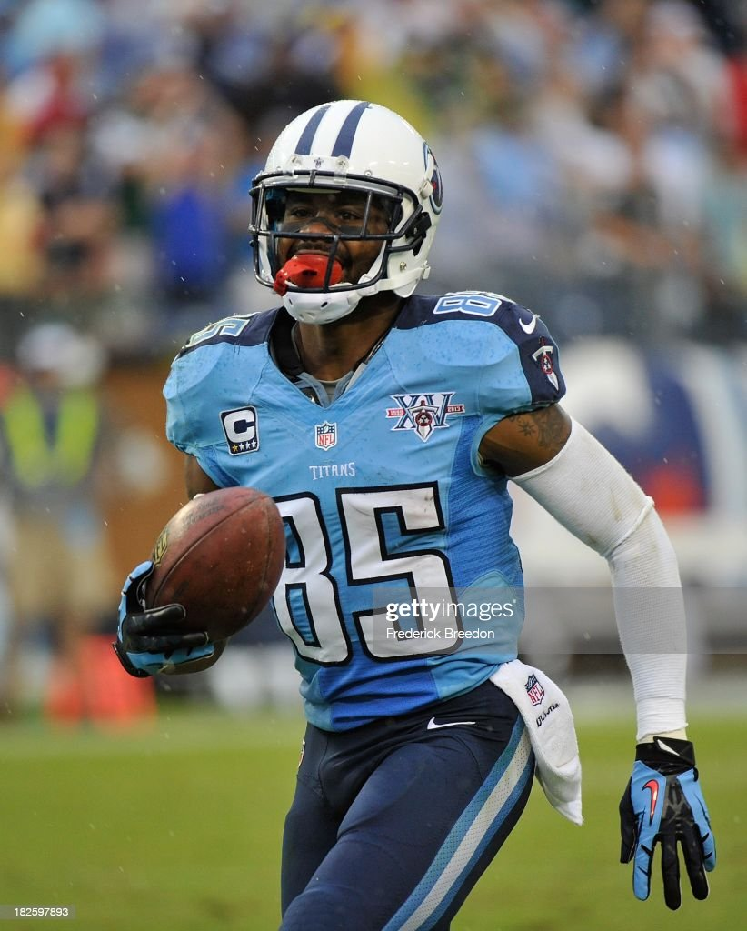 <a gi-track='captionPersonalityLinkClicked' href=/galleries/search?phrase=Nate+Washington&family=editorial&specificpeople=748657 ng-click='$event.stopPropagation()'>Nate Washington</a> #85 of the Tennessee Titans smiles as he enters the end zone for a touchdown against the New York Jets at LP Field on September 29, 2013 in Nashville, Tennessee.