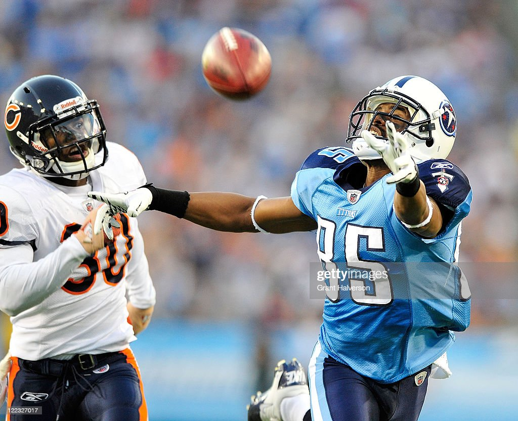 <a gi-track='captionPersonalityLinkClicked' href=/galleries/search?phrase=Nate+Washington&family=editorial&specificpeople=748657 ng-click='$event.stopPropagation()'>Nate Washington</a> #85 of the Tennessee Titans stretches for an overthrown pass as D.J. Moore #30 of the Chicago Bears defends during a preseason game at LP Field on August 27, 2011 in Nashville, Tennessee.