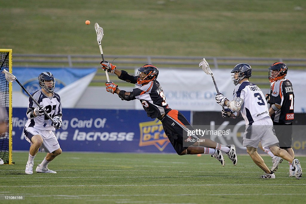 Nate Watkins of the Denver Outlaws passes the ball against the Chesapeake Bayhawks during the first half at NavyMarine Corps Memorial Stadium on...