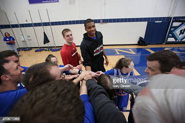 Nate Wolters and Giannis Antetokounmpo of the Milwaukee Bucks interact with participants during a Special Olympics basketball skills clinic on...