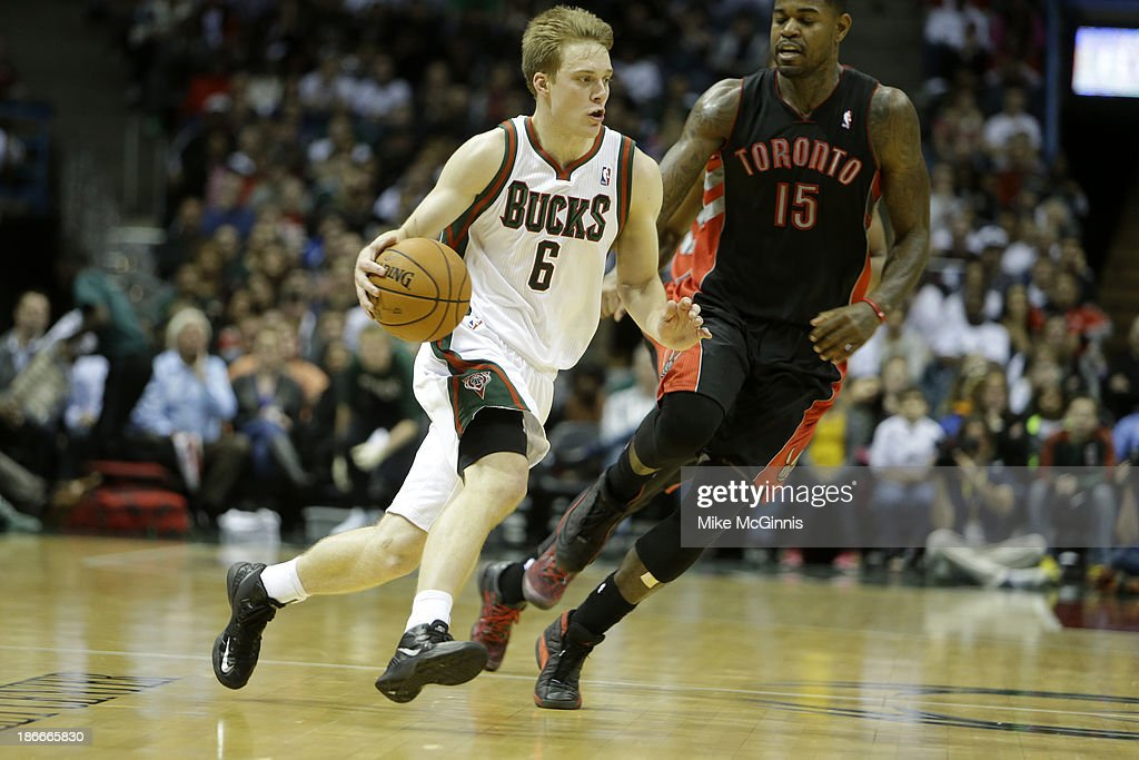 <a gi-track='captionPersonalityLinkClicked' href=/galleries/search?phrase=Nate+Wolters&family=editorial&specificpeople=9023990 ng-click='$event.stopPropagation()'>Nate Wolters</a> #6 of the Milwaukee Bucks dribbles up the court during the second half against the Toronto Raptors at Bradley Center on November 2, 2013 in Milwaukee, Wisconsin.