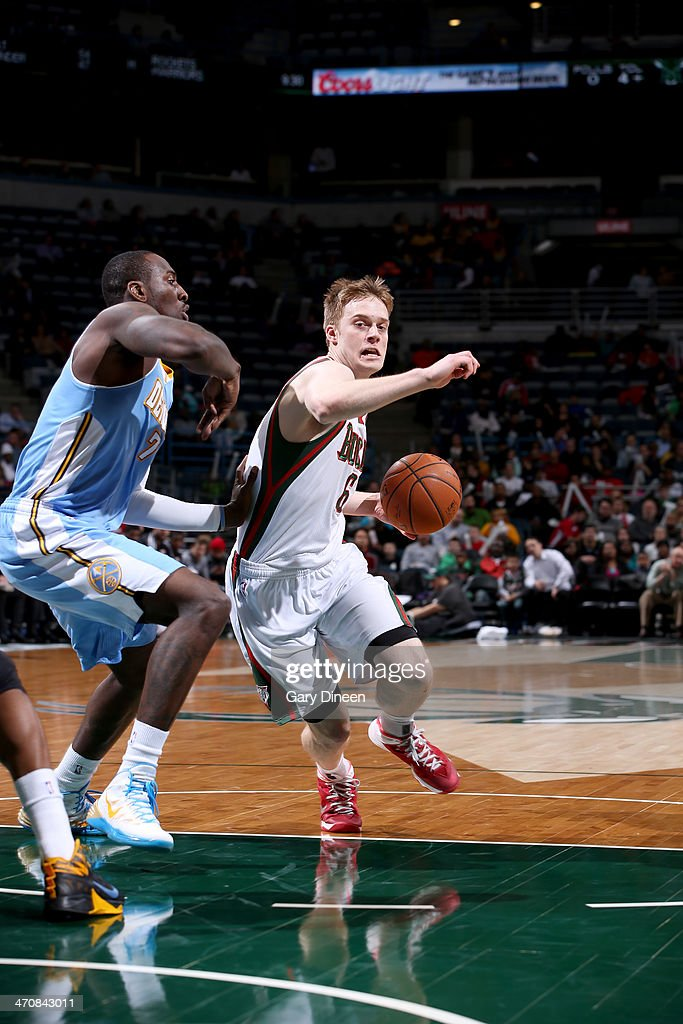 <a gi-track='captionPersonalityLinkClicked' href=/galleries/search?phrase=Nate+Wolters&family=editorial&specificpeople=9023990 ng-click='$event.stopPropagation()'>Nate Wolters</a> #6 of the Milwaukee Bucks drives to the basket against J.J. Hickson #7 of the Denver Nuggets on February 20, 2014 at the BMO Harris Bradley Center in Milwaukee, Wisconsin.