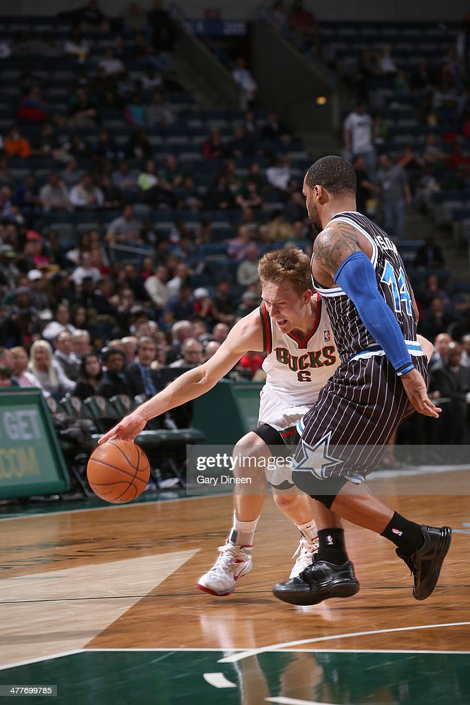 Nate Wolters #6 of the Milwaukee Bucks drives to the basket against Jameer Nelson #14 of the Orlando Magic on March 10, 2014 at the BMO Harris Bradley Center in Milwaukee, Wisconsin.