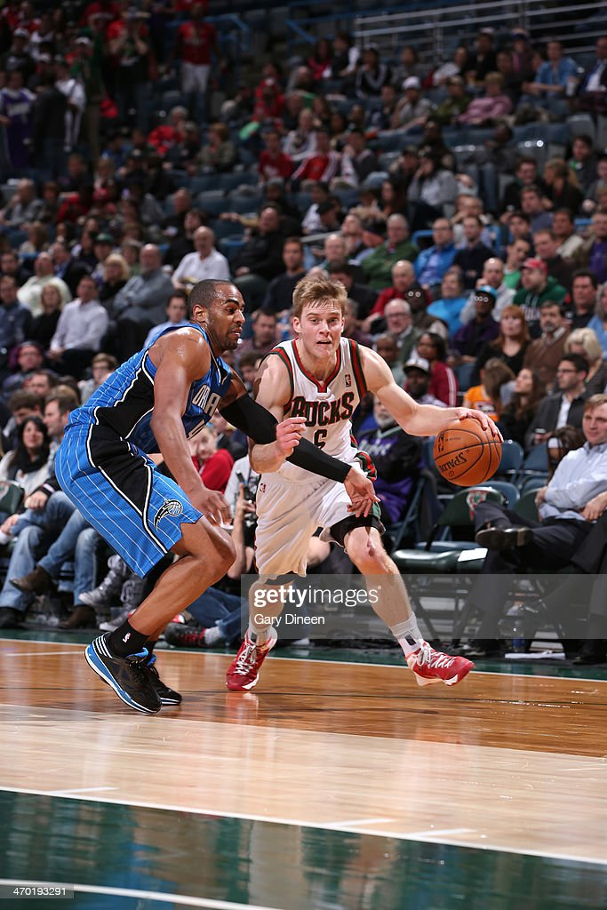 <a gi-track='captionPersonalityLinkClicked' href=/galleries/search?phrase=Nate+Wolters&family=editorial&specificpeople=9023990 ng-click='$event.stopPropagation()'>Nate Wolters</a> #6 of the Milwaukee Bucks drives to the basket against the Orlando Magic on February 18, 2014 at the BMO Harris Bradley Center in Milwaukee, Wisconsin.