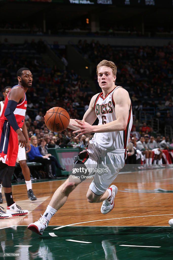 <a gi-track='captionPersonalityLinkClicked' href=/galleries/search?phrase=Nate+Wolters&family=editorial&specificpeople=9023990 ng-click='$event.stopPropagation()'>Nate Wolters</a> #6 of the Milwaukee Bucks drives to the basket against the Washington Wizards on March 8, 2014 at the BMO Harris Bradley Center in Milwaukee, Wisconsin.