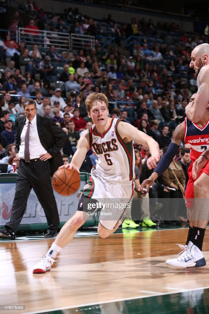Nate Wolters #6 of the Milwaukee Bucks drives to the basket against the Washington Wizards on March 8, 2014 at the BMO Harris Bradley Center in Milwaukee, Wisconsin.