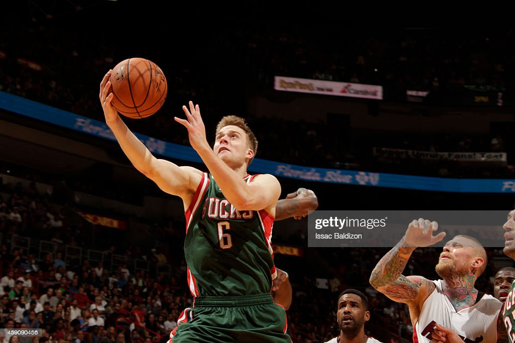 <a gi-track='captionPersonalityLinkClicked' href=/galleries/search?phrase=Nate+Wolters&family=editorial&specificpeople=9023990 ng-click='$event.stopPropagation()'>Nate Wolters</a> #6 of the Milwaukee Bucks goes up for a shot against the Miami Heat during the game on November 16, 2014 at AmericanAirlines Arena in Miami, Florida.