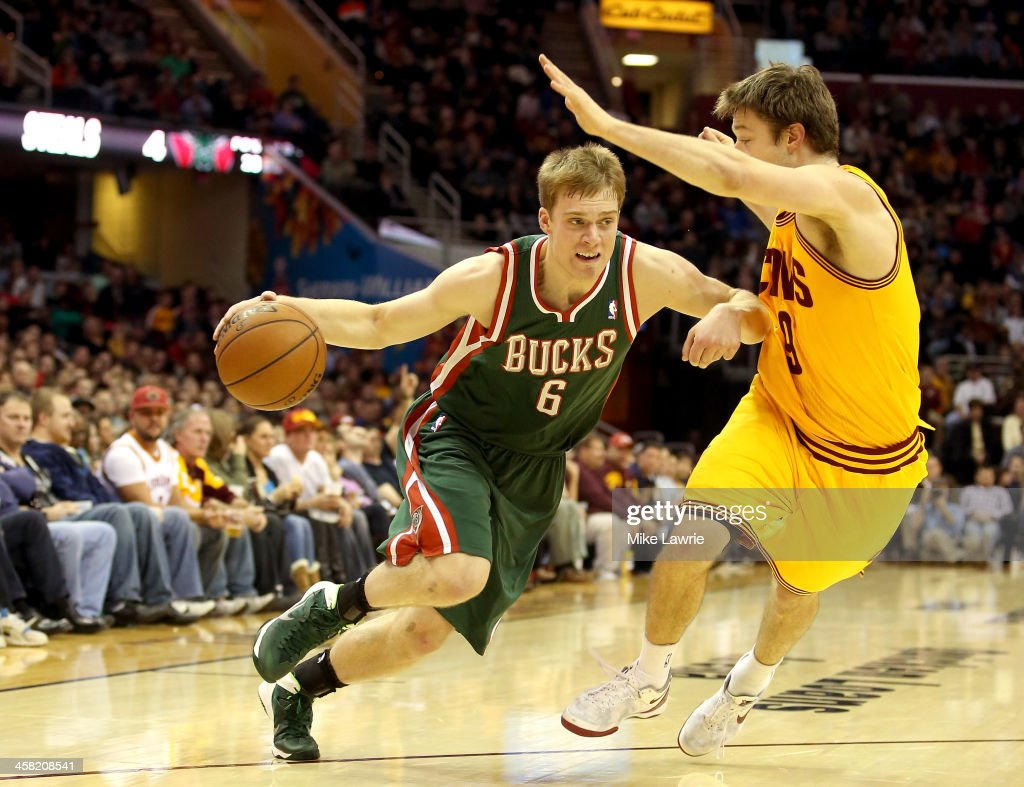 <a gi-track='captionPersonalityLinkClicked' href=/galleries/search?phrase=Nate+Wolters&family=editorial&specificpeople=9023990 ng-click='$event.stopPropagation()'>Nate Wolters</a> #6 of the Milwaukee Bucks handles the ball against <a gi-track='captionPersonalityLinkClicked' href=/galleries/search?phrase=Matthew+Dellavedova&family=editorial&specificpeople=5948739 ng-click='$event.stopPropagation()'>Matthew Dellavedova</a> #9 of the Cleveland Cavaliers in the first half at Quicken Loans Arena on December 20, 2013 in Cleveland, Ohio.