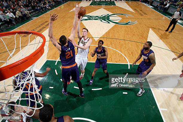 Nate Wolters of the Milwaukee Bucks shoots against Alex Len of the Phoenix Suns on January 29 2014 at the BMO Harris Bradley Center in Milwaukee...