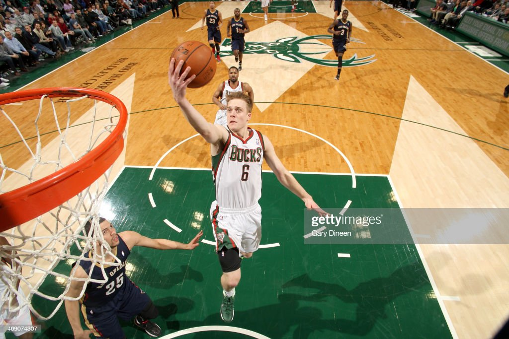 <a gi-track='captionPersonalityLinkClicked' href=/galleries/search?phrase=Nate+Wolters&family=editorial&specificpeople=9023990 ng-click='$event.stopPropagation()'>Nate Wolters</a> #6 of the Milwaukee Bucks shoots against Austin Rivers #25 of the New Orleans Pelicans on February 12, 2014 at the BMO Harris Bradley Center in Milwaukee, Wisconsin.