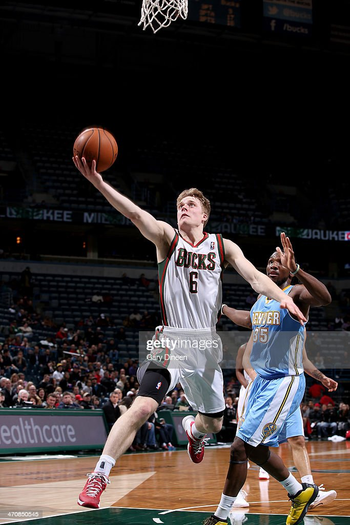<a gi-track='captionPersonalityLinkClicked' href=/galleries/search?phrase=Nate+Wolters&family=editorial&specificpeople=9023990 ng-click='$event.stopPropagation()'>Nate Wolters</a> #6 of the Milwaukee Bucks shoots against <a gi-track='captionPersonalityLinkClicked' href=/galleries/search?phrase=Kenneth+Faried&family=editorial&specificpeople=5765135 ng-click='$event.stopPropagation()'>Kenneth Faried</a> #35 of the Denver Nuggets on February 20, 2014 at the BMO Harris Bradley Center in Milwaukee, Wisconsin.
