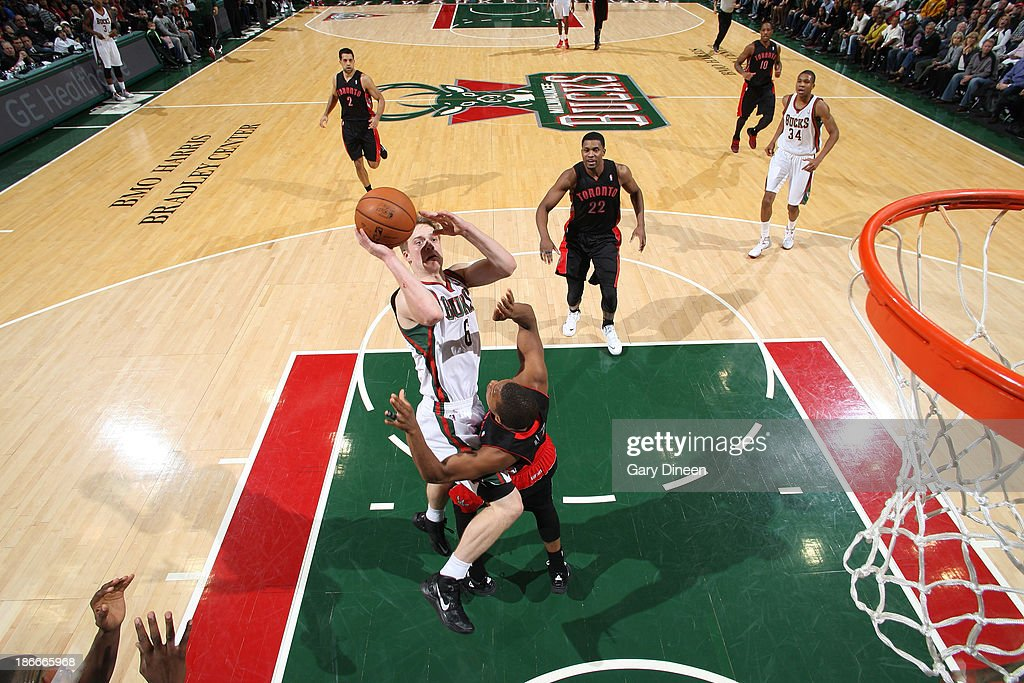 <a gi-track='captionPersonalityLinkClicked' href=/galleries/search?phrase=Nate+Wolters&family=editorial&specificpeople=9023990 ng-click='$event.stopPropagation()'>Nate Wolters</a> #6 of the Milwaukee Bucks shoots against <a gi-track='captionPersonalityLinkClicked' href=/galleries/search?phrase=Kyle+Lowry&family=editorial&specificpeople=714625 ng-click='$event.stopPropagation()'>Kyle Lowry</a> #7 of the Toronto Raptors on November 2, 2013 at the BMO Harris Bradley Center in Milwaukee, Wisconsin.