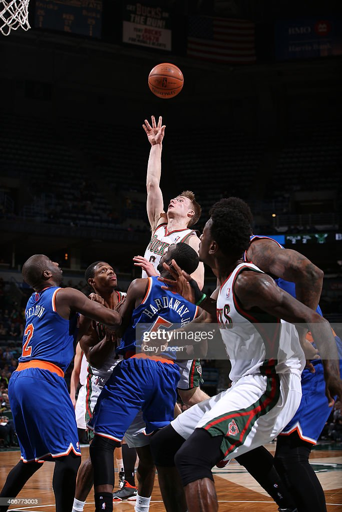 Nate Wolters #6 of the Milwaukee Bucks shoots against (L-R) Raymond Felton #2 and Tim Hardaway Jr. #5 of the New York Knicks on February 3, 2014 at the BMO Harris Bradley Center in Milwaukee, Wisconsin.