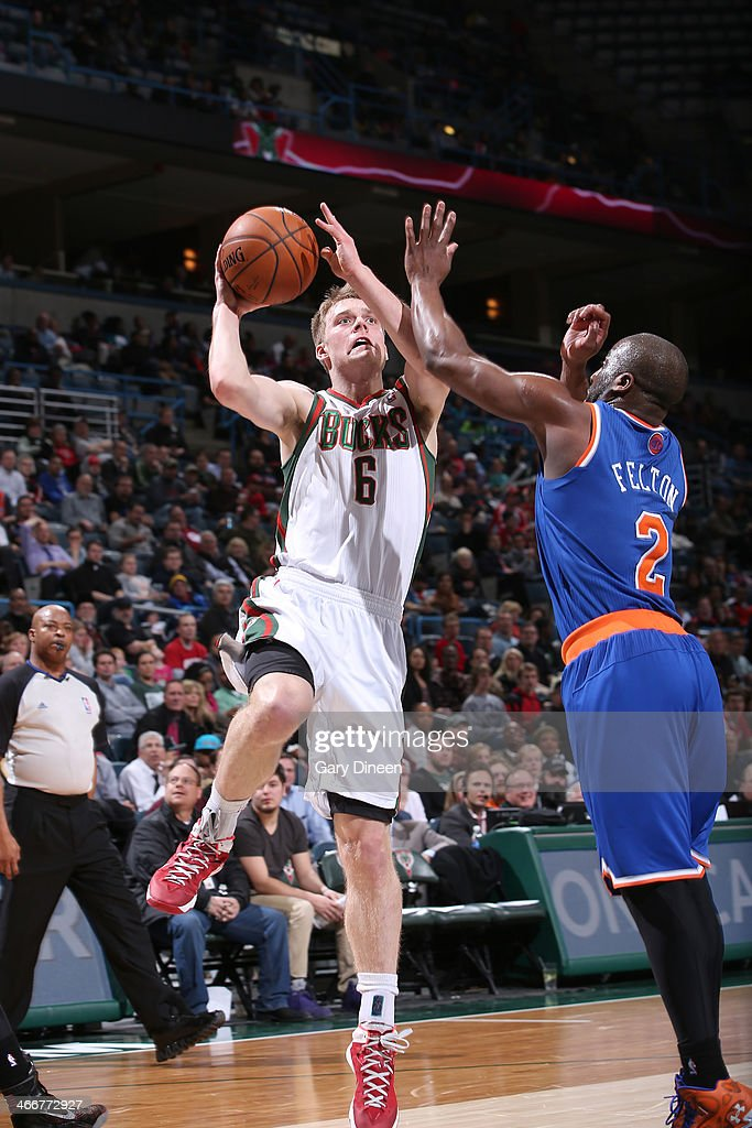 Nate Wolters #6 of the Milwaukee Bucks shoots against Raymond Felton #2 of the New York Knicks on February 3, 2014 at the BMO Harris Bradley Center in Milwaukee, Wisconsin.