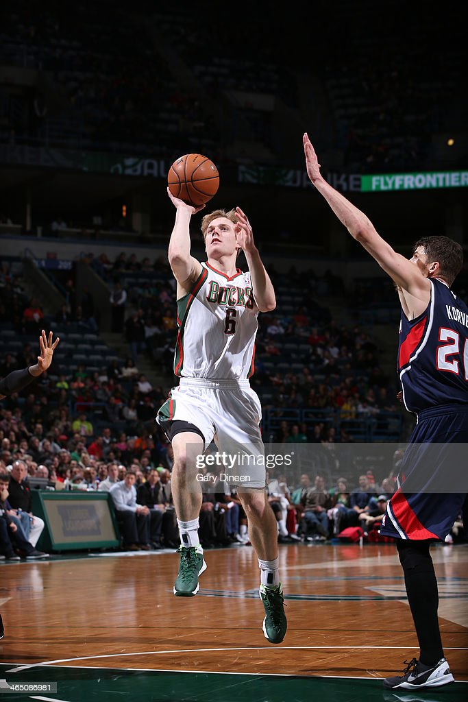 <a gi-track='captionPersonalityLinkClicked' href=/galleries/search?phrase=Nate+Wolters&family=editorial&specificpeople=9023990 ng-click='$event.stopPropagation()'>Nate Wolters</a> #6 of the Milwaukee Bucks shoots against the Atlanta Hawks on January 25, 2014 at the BMO Harris Bradley Center in Milwaukee, Wisconsin.