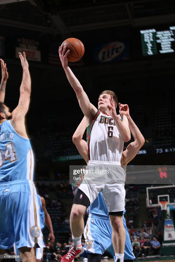 <a gi-track='captionPersonalityLinkClicked' href=/galleries/search?phrase=Nate+Wolters&family=editorial&specificpeople=9023990 ng-click='$event.stopPropagation()'>Nate Wolters</a> #6 of the Milwaukee Bucks shoots against the Denver Nuggets on February 20, 2014 at the BMO Harris Bradley Center in Milwaukee, Wisconsin.