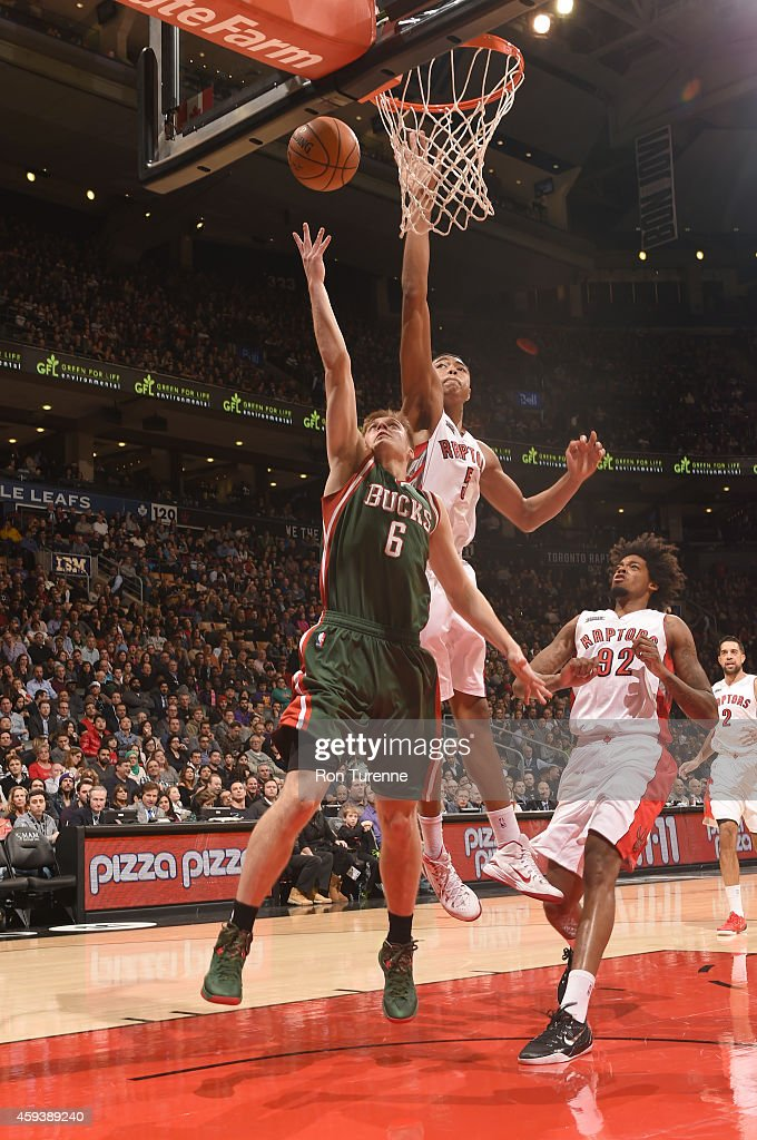 <a gi-track='captionPersonalityLinkClicked' href=/galleries/search?phrase=Nate+Wolters&family=editorial&specificpeople=9023990 ng-click='$event.stopPropagation()'>Nate Wolters</a> #6 of the Milwaukee Bucks shoots the ball against the Toronto Raptors during the game on November 21, 2014 at the Air Canada Centre in Toronto, Ontario, Canada.
