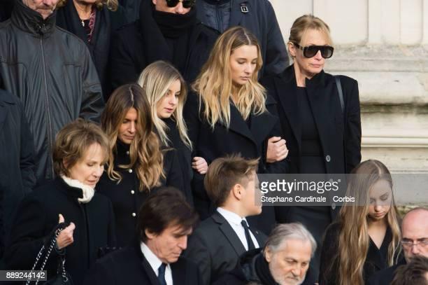 Nathalie Baye Darina Scotti Ilona Smet Estelle Lefebure Cameron Hallyday and Emma Hallyday leave the church during Johnny Hallyday's Funeral at...