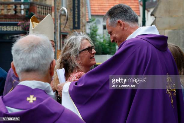 Nathalie daughter of late French actor Claude Rich arrives for the funeral ceremony at the Saint Pierre Saint Paul Church in Orgeval northcentral...