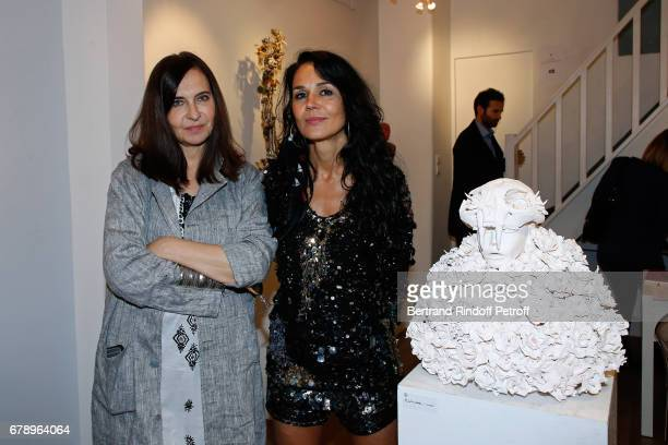 Nathalie Garcon and actress Catherine Wilkening attend Catherine Wilkening signs her book 'Les mots avales' and exhibits her works at Galerie...