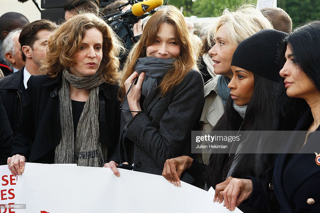 Nathalie Kosciusko Morizet, <a gi-track='captionPersonalityLinkClicked' href=/galleries/search?phrase=Carla+Bruni&family=editorial&specificpeople=235729 ng-click='$event.stopPropagation()'>Carla Bruni</a> Sarkozy, Valerie Pecresse and <a gi-track='captionPersonalityLinkClicked' href=/galleries/search?phrase=Mia+Frye&family=editorial&specificpeople=763514 ng-click='$event.stopPropagation()'>Mia Frye</a> participate to the demonstration in support for kidnapped Nigerian schoolgirls at the Trocadero on May 13, 2014 in Paris, France.
