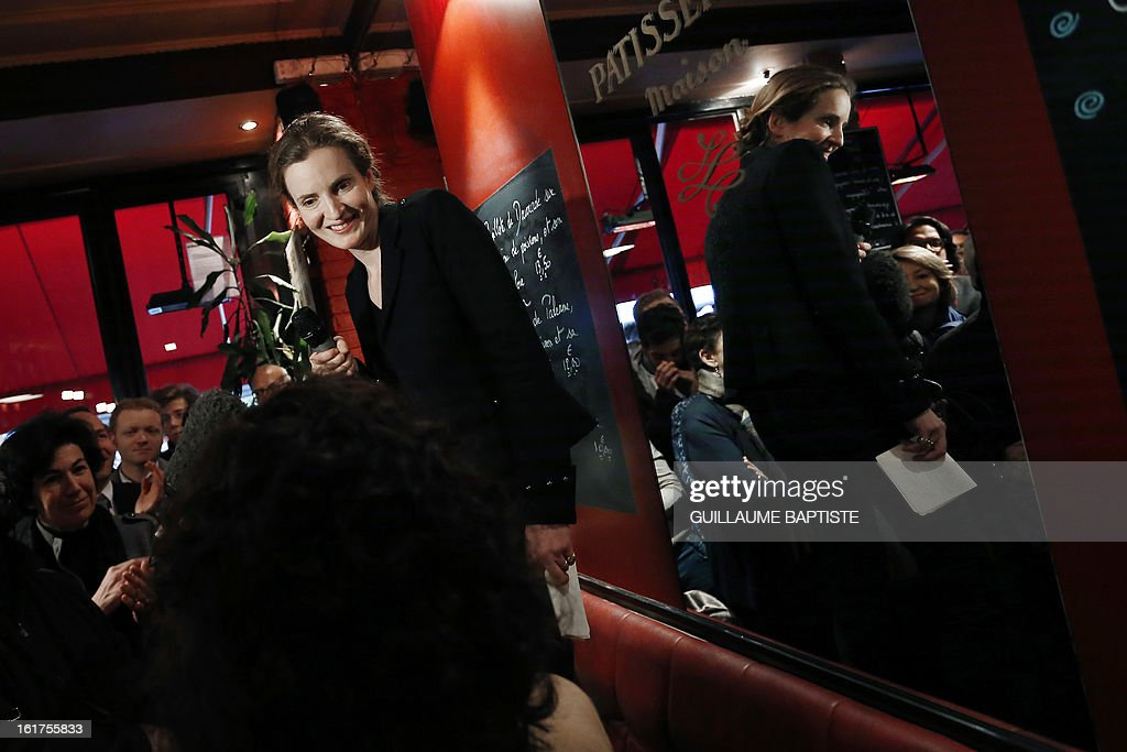 Nathalie Kosciusko-Morizet, a member of the French opposition right-wing UMP party, meets people, on February 15, 2013 at a cafe in Paris following the announcement of her candidacy for the UMP internal vote to pick the party candidate for the 2014 Paris municipal elections. BAPTISTE