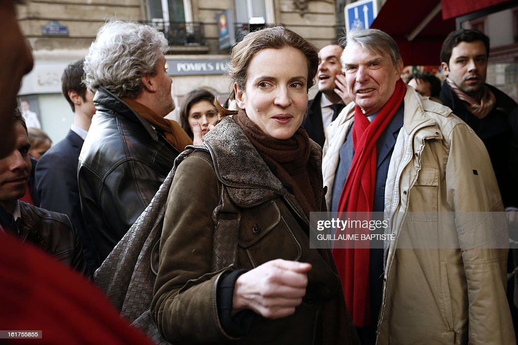 Nathalie Kosciusko-Morizet (C), a member of the French opposition right-wing UMP party, arrives to meet people, on February 15, 2013, at a cafe in Paris following the announcement of her candidacy for the UMP internal vote to pick the party candidate for the 2014 Paris municipal elections. BAPTISTE