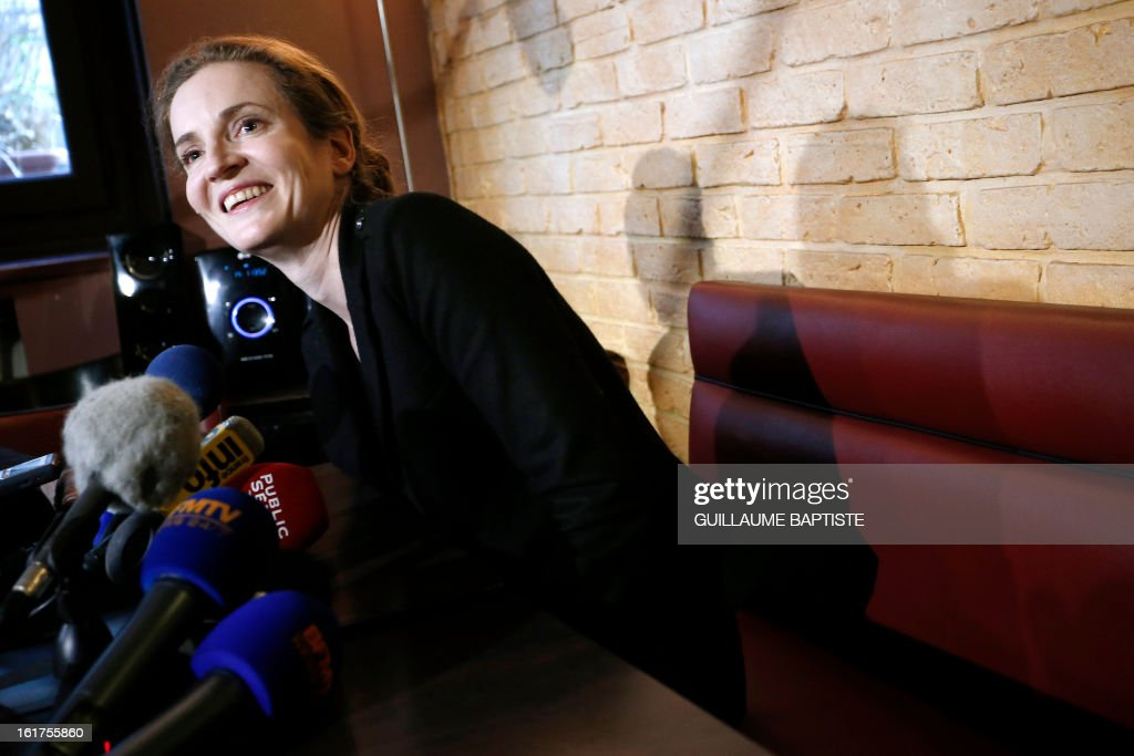 Nathalie Kosciusko-Morizet (C), a member of the French opposition right-wing UMP party, gives a press conference, on February 15, 2013, at a cafe in Paris following the announcement of her candidacy for the UMP internal vote to pick the party candidate for the 2014 Paris municipal elections. BAPTISTE