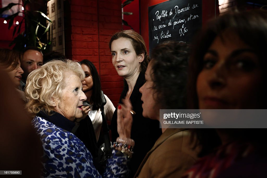 Nathalie Kosciusko-Morizet (C), a member of the French opposition right-wing UMP party, meets people, on February 15, 2013 at a cafe in Paris following the announcement of her candidacy for the UMP internal vote to pick the party candidate for the 2014 Paris municipal elections. BAPTISTE