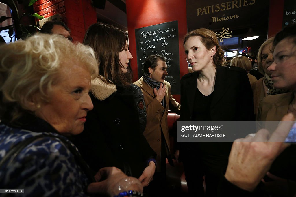 Nathalie Kosciusko-Morizet (R), a member of the French opposition right-wing UMP party, meets people, on February 15, 2013 at a cafe in Paris following the announcement of her candidacy for the UMP internal vote to pick the party candidate for the 2014 Paris municipal elections. BAPTISTE
