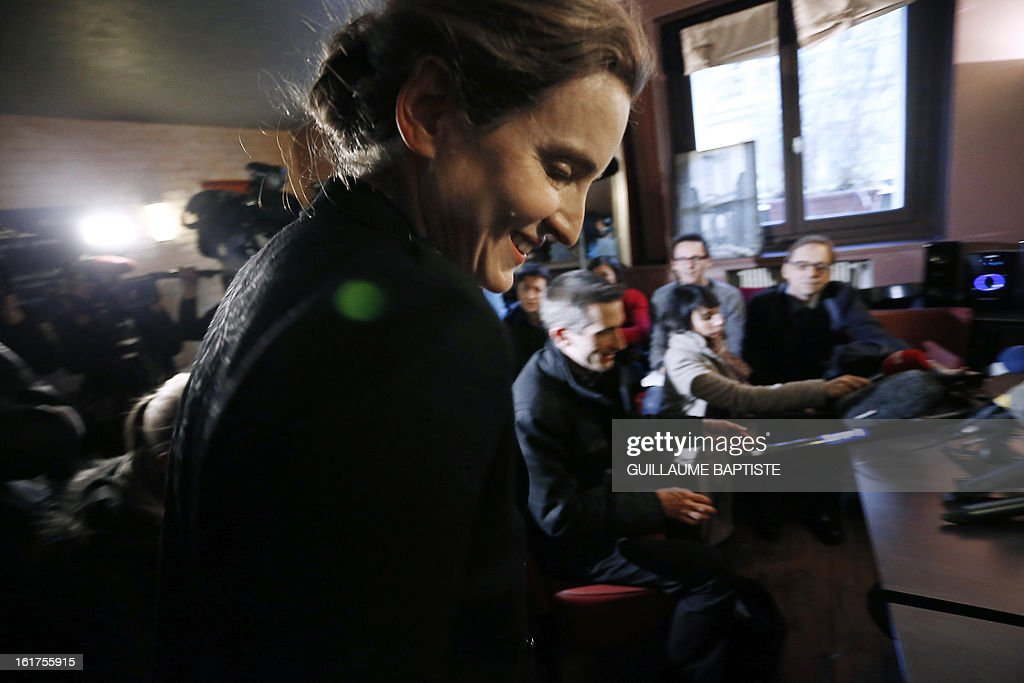 Nathalie Kosciusko-Morizet (C), a member of the French opposition right-wing UMP party, arrives to meet people, on February 15, 2013 at a cafe in Paris following the announcement of her candidacy for the UMP internal vote to pick the party candidate for the 2014 Paris municipal elections. BAPTISTE