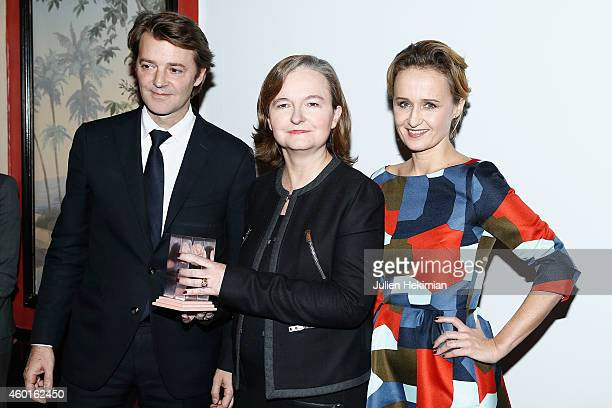 Nathalie Loiseau is pictured with Francois Baroin and Caroline Roux after being awarded during the 'Prix De La Femme D'Influence 2014' Ceremony At...