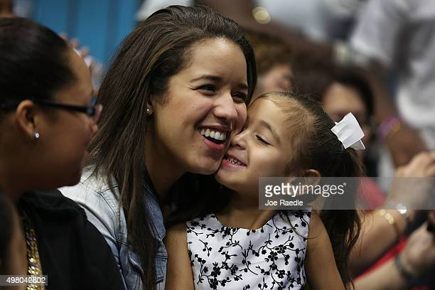 Nathalie Ogando sits with her adopted cousin Lean Martinez after she was adopted during a ceremony in an adoption court on National Adoption Day...