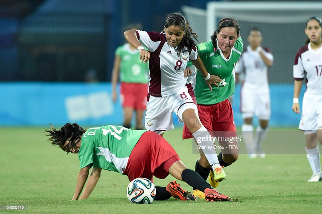 Nathalie Pasquel (C) of Venezuela competes with Kimberly Rodriguez #4 and Duice Martinez of Mexico during the 2014 FIFA Girls Summer Youth Olympic Football Tournament Semi Final match between Venezuela and Mexico at Wutaishan Stadium on August 23, 2014 in Nanjing, China.
