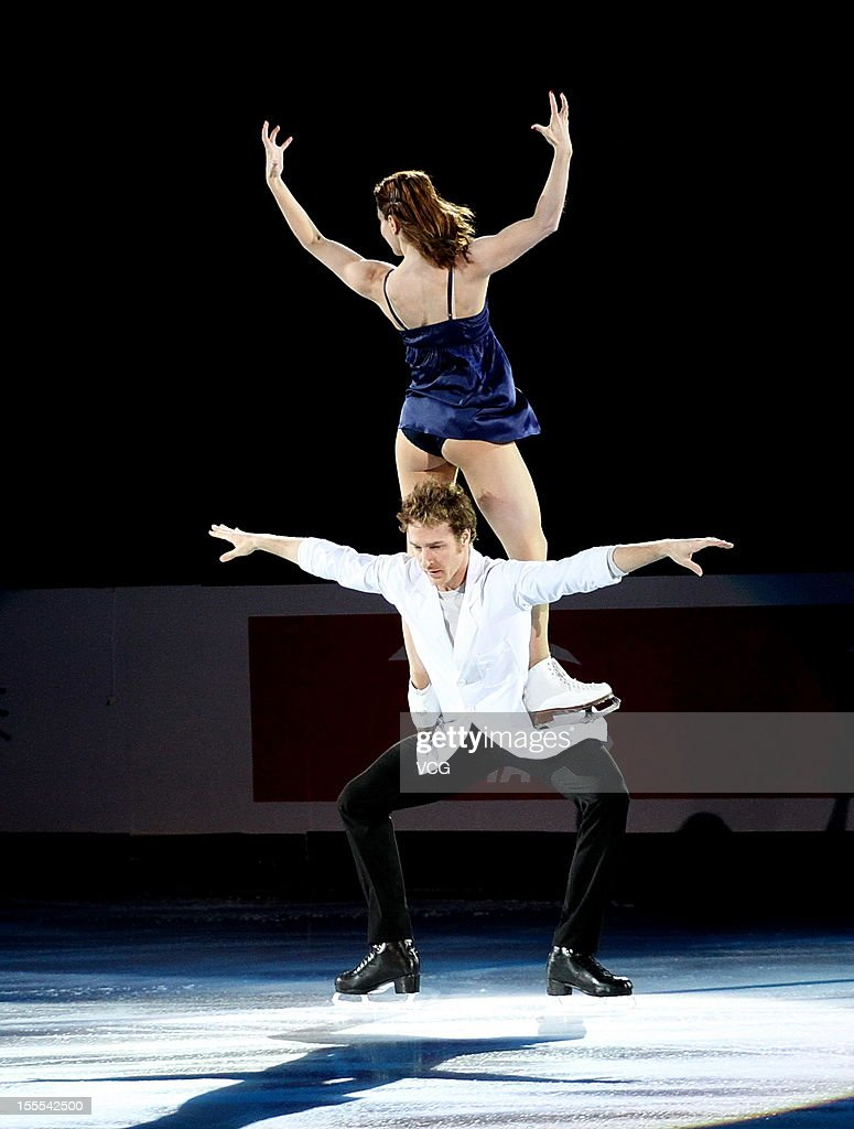 Nathalie Pechalat and Fabian Bourzat of France perform during the Cup of China ISU Grand Prix of Figure Skating 2012 at the Oriental Sports Center on...