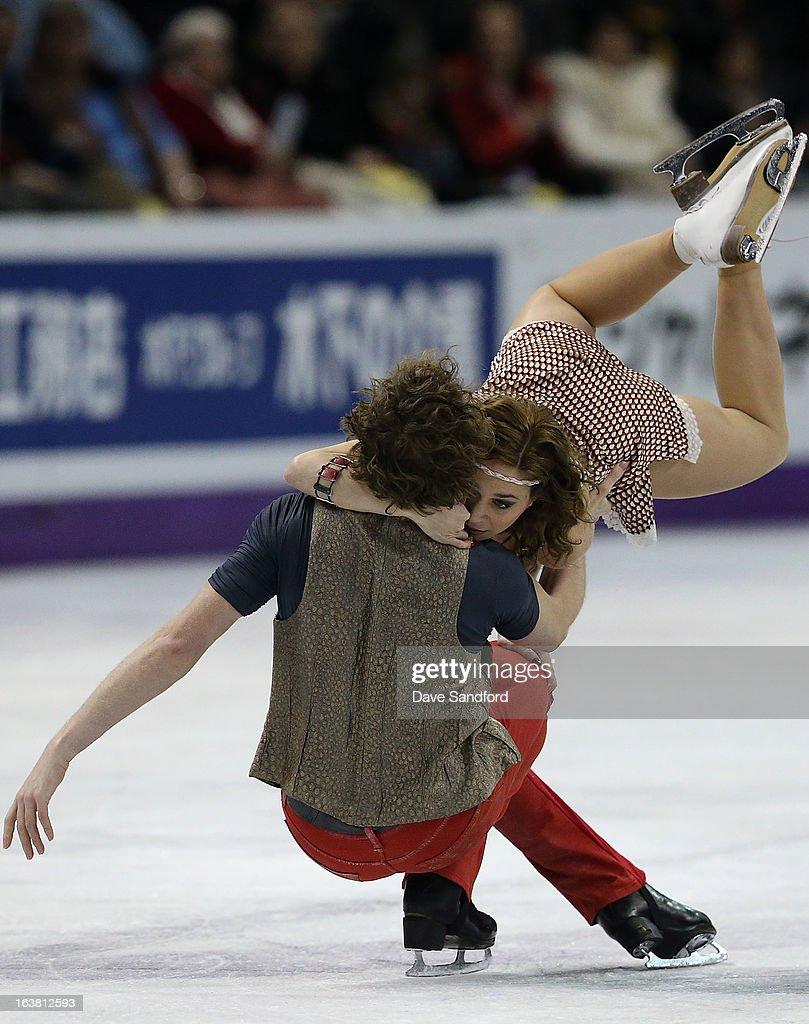 Nathalie Pechalat and Fabian Bourzat of France skate in the Ice Dance Free Dance Program during the 2013 ISU World Figure Skating Championships at Budweiser Gardens on March 16, 2013 in London, Ontario, Canada.
