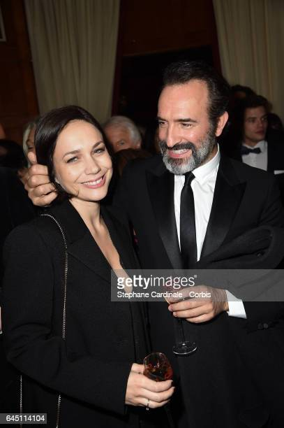 Nathalie Pechalat and Jean Dujardin attend the Cesar Dinner at Le Fouquet's on February 24 2017 in Paris France