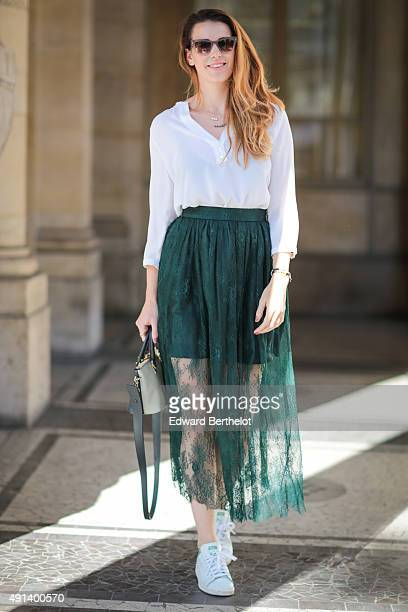 Nathalie Van Den Berg wearing a Zara blouse a Pinko skirt a Chloe bag Adidas shoes and Prada sunglasses before the Isabel Marant show during the...