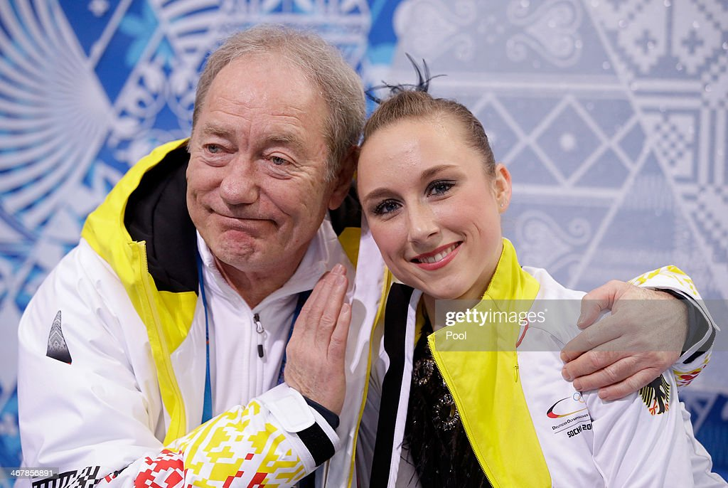 <a gi-track='captionPersonalityLinkClicked' href=/galleries/search?phrase=Nathalie+Weinzierl&family=editorial&specificpeople=8823412 ng-click='$event.stopPropagation()'>Nathalie Weinzierl</a> of Germany waits for her score with a member of her team during the Figure Skating Team Ladies Short Program during day one of the Sochi 2014 Winter Olympics at Iceberg Skating Palace on February 8, 2014 in Sochi, Russia.