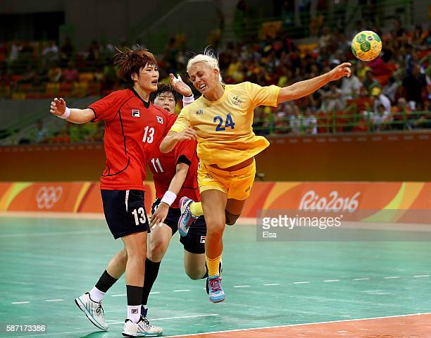Nathalile Hagman of Sweden takes a shot as Hyunji Yoo of Korea defends on Day 3 of the Rio 2016 Olympic Games at the Future Arena on August 8 2016 in...