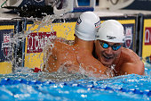 Nathan Adrian and Anthony Ervin of the United States celebrate after competing in the final heat for the Men's 50 Meter Freestyle during Day Seven of...
