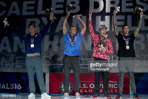 Nathan Adrian Caeleb Dressel Ryan Held and Anthony Ervin of the United States participate in the medal ceremony for the Men's 100 Meter Freestyle...